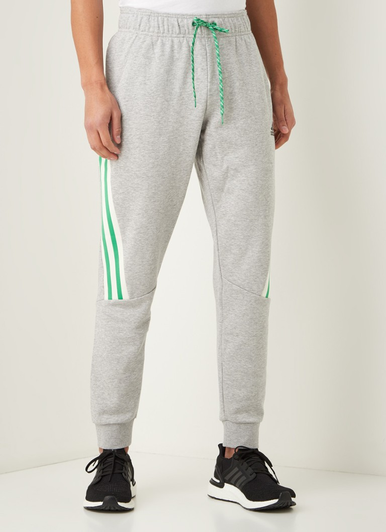 adidas - 3-Stripes tapered fit joggingbroek met gestreept detail - Grijsmele