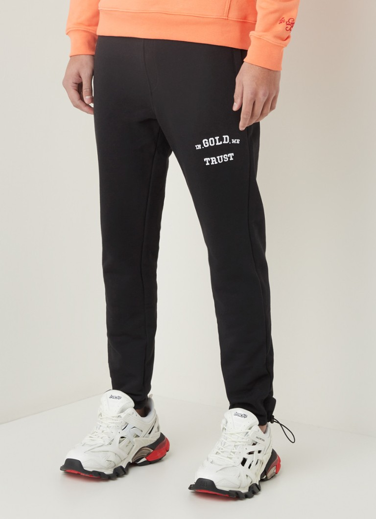 In Gold We Trust - Tapered fit joggingbroek met logoborduring - Zwart