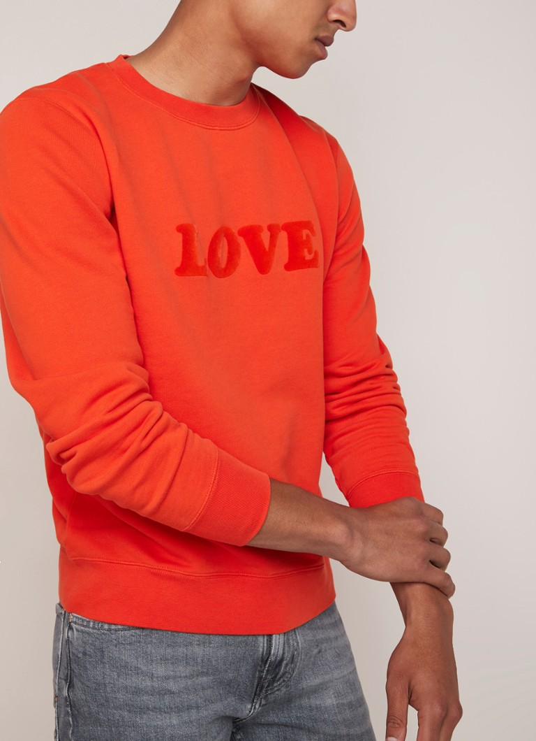 Sandro - Love sweater met flockprint - Oranje
